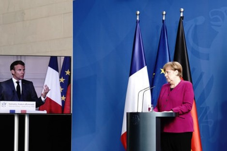 German Chancellor Angela Merkel speaking in Berlin with French President Emmanuel Macron on a TV link from Paris.