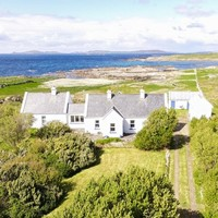 Escape to this picture-perfect Connemara cottage with a private beach - yours for €450k