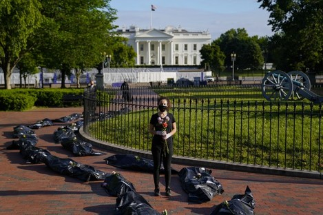 Margot Bloch from Maryland participates in a protest over President Trump's handling go the coronavirus pandemic.