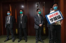 Three politicians ejected from Hong Kong chamber amid China anthem debate