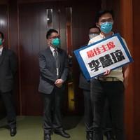Three politicians ejected from Hong Kong chamber amid China anthem debate