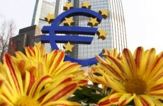 ECB cuts interest rate to record low