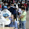 Handful of Covid-19 cases found as Wuhan tests 10 million residents