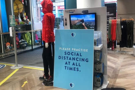 Inside the Great Outdoors store where social distancing measures have been installed.