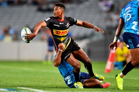 The Stormers' Damian Willemse offloads in a tackle against the Blues last season.