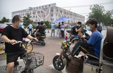 Parts of Beijing locked down after dozens of people test positive for Covid-19