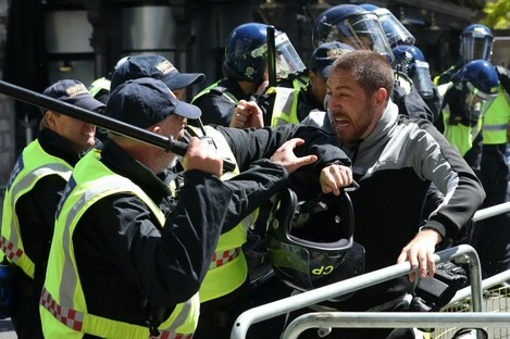 Police clash with protesters in London today.