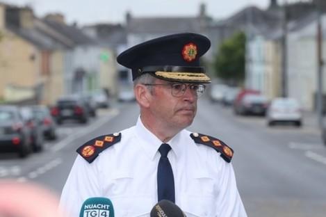 Garda Commissioner Drew Harris speaking to the media at the scene in Castlerea.