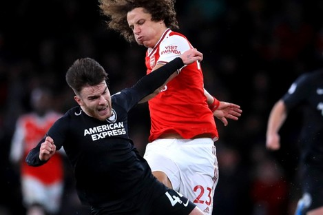 Aaron Connolly tangles with David Luiz during the Premier League game between Arsenal and Brighton last December.