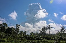 Indonesia's most active volcano spews ash and hot gas 6km into the sky