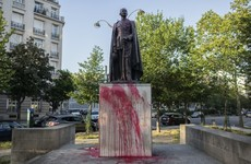 Two statues relating to France's colonial era daubed in paint in Paris