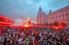 Glasses and bottles thrown at police in violent clash between police and football fans in Liverpool