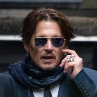 Johnny Depp in breach of court order in libel case against Sun newspaper, UK High Court rules