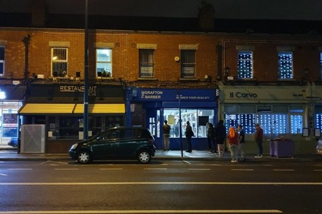 People queuing outside a Grafton Barbers shop in Drumcondra at 12.50am.