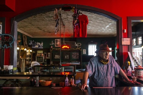 Owner Tom Garrison looks out from his bar, Stoneleigh P, in the Oak Lawn area of Dallas, Texas.