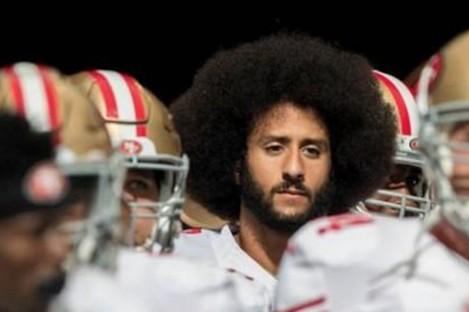 Colin Kaepernick emerges with 49ers team-mates for a game against the Miami Dolphins in 2016.