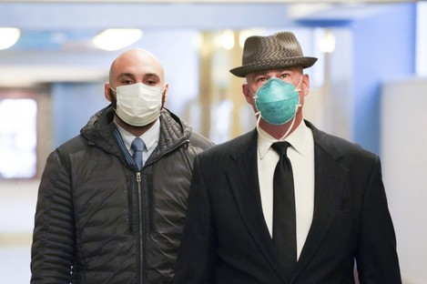 Former Minneapolis police officer J Alexander Kueng (left) enters the Hennepin County Public Safety Facility in Minneapolis yesterday.