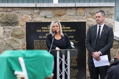 Deputy First Minister Michelle O'Neill speaks alongside Sinn Fein TD Pearse Doherty during the funeral of senior republican figure Bobby Storey.