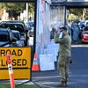 Australia to close border between Victoria and New South Wales after virus spike