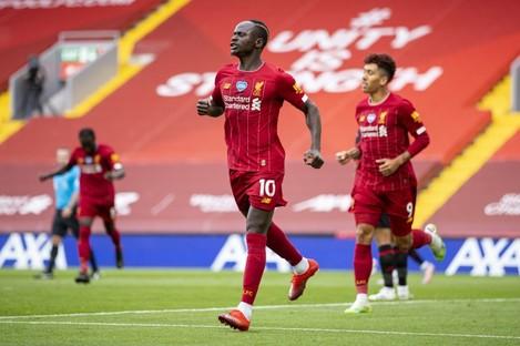 Sadio Mane celebrates scoring against Aston Villa.