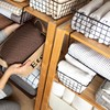 'Folded towels are a waste of space': 9 storage mistakes most people make - and how to fix them