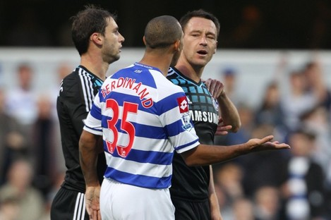 Chelsea captain John Terry (right) speaking with QPR's Anton Ferdinand last October.
