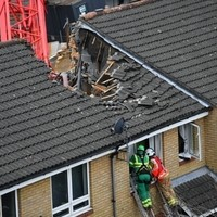 One person dies after crane collapses in London