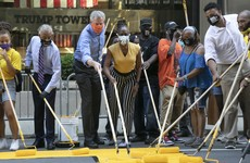 New York mayor helps paint Black Lives Matter in front of Trump Tower
