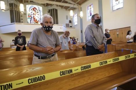 People pray in a California church on Sunday.