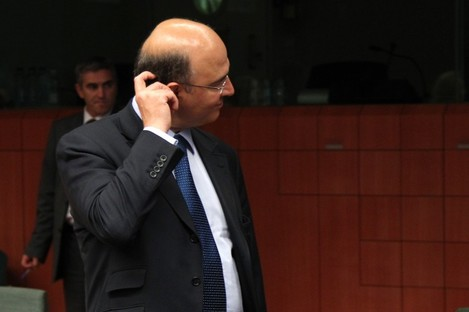 French Finance Minister Pierre Moscovici scratches his head during the Eurogroup meeting