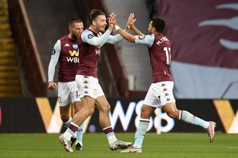 Aston Villa players celebrate Trezeguet's goal.
