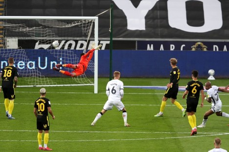 Swansea City's Andre Ayew (right) scores.