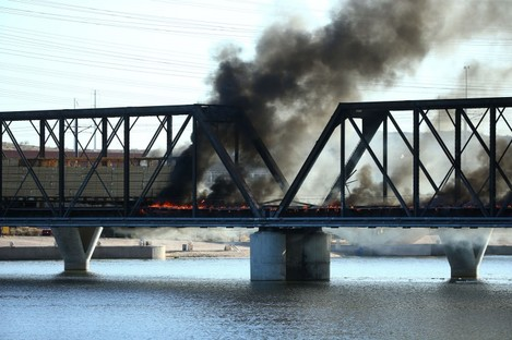 The train is on fire and the bridge has collapsed in Tempe, Arizona.