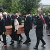 John Hume's body makes final journey home