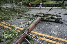 Six people die after tropical storm Isaias sweeps up the east coast of the US