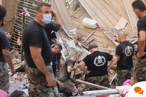 Rescuers search for survivors after the explosions in Beirut.