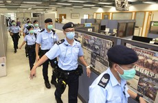 Hong Kong newspaper owner arrested during office raid by police