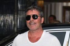 Simon Cowell recovering from surgery after breaking part of his back in bike fall