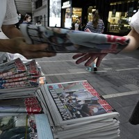 Hong Kong residents rush to buy pro-democracy newspaper following owner's arrest