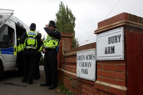 Police at the Greenacres site at the time of the arrests last year
