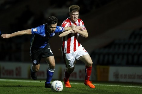 Cameron McJannet (right) tangling with Joe Rafferty during a Checkatrade Trophy game between Stoke City and Rochdale.