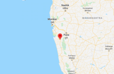 At least 70 people feared trapped after five-storey building collapses in India