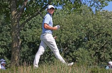 Rory McIlroy powers into share of the lead on day two in Chicago