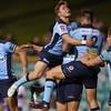 Waratahs keep Super Rugby hopes alive after edging out Rebels in nine-try thriller