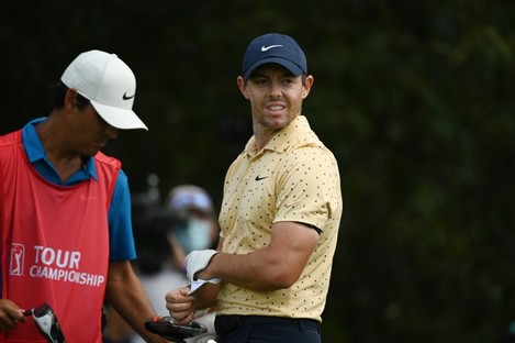Rory McIlroy reacts to his tee shot on the 3rd hole.