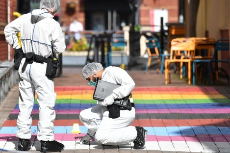 Police forensic officers in Hurst Walk in Birmingham yesterday after a number of people were stabbed in the city centre.