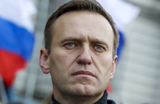 Alexei Navalny out of induced coma and responsive, says German hospital