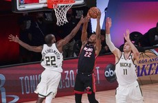Miami Heat blaze on after sending injury-hit Milwaukee Bucks home