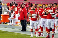 Audible booing in reduced crowd as NFL returns with 'moment of unity'