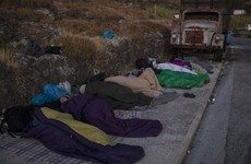 Thousands sleep outside after Greek refugee camp burns down